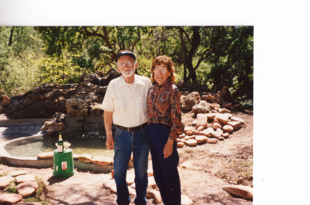 Wally and Marion Paton celebrating the completion of the newly completed fountain at Paton's Birder Haven. Photo taken by the ©Paton Family. All Rights Reserved. Photo may not be used without  written permission. Please respect the Paton Family.
